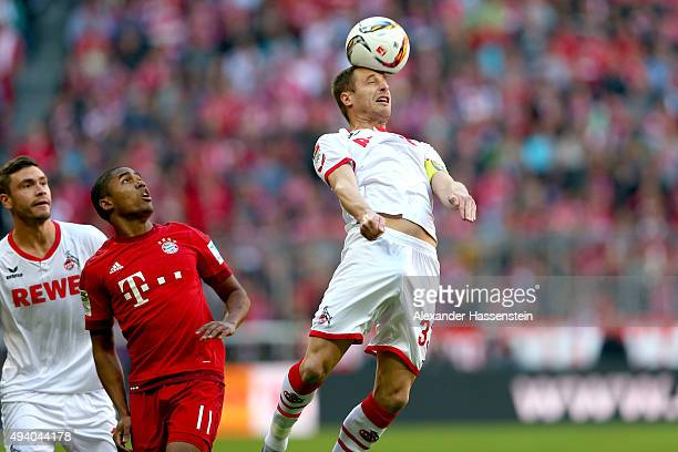 Matthias Lehmann of Koeln battles for the ball with Douglas Costa of Muenchen and Jonas Hector of Koeln during the Bundesliga match between FC Bayern...