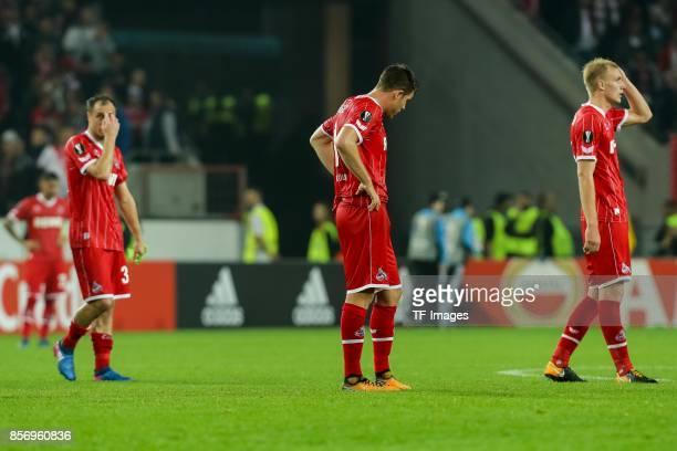 Matthias Lehmann of Koeln Dominique Heintz of Koeln Frederik Hillesborg Sorensen of Koeln looks dejected during the UEFA Europa League group H match...