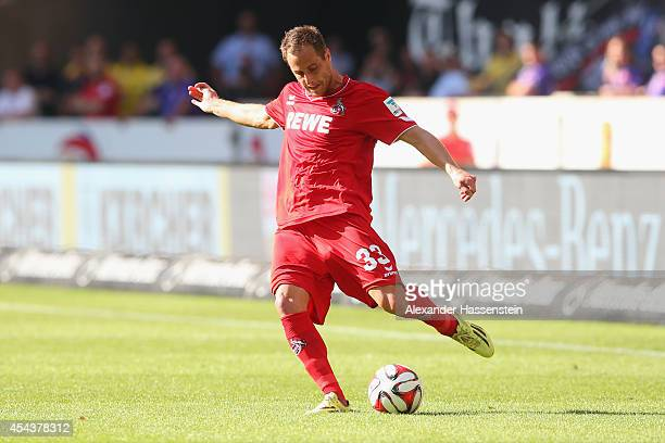 Matthias Lehmann of Koeln runs with the ball during the Bundesliga match between VfB Stuttgart and 1 FC Koeln at MercedesBenz Arena on August 30 2014...