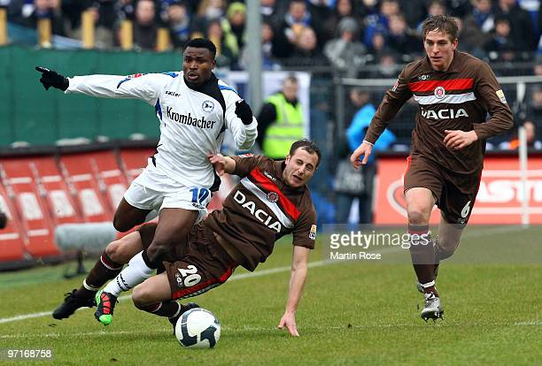 Matthias Lehmann of St Pauli and Christopher Katongo of Bielefeld battle for the ball during the Second Bundesliga match between FC St Pauli and...