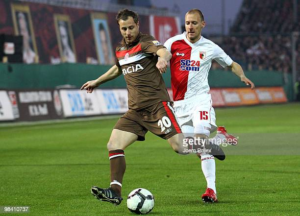 Matthias Lehmann of St Pauli and Dominik Reinhardt of Augsburg compete for the ball during the Second Bundesliga match between FC St Pauli and FC...