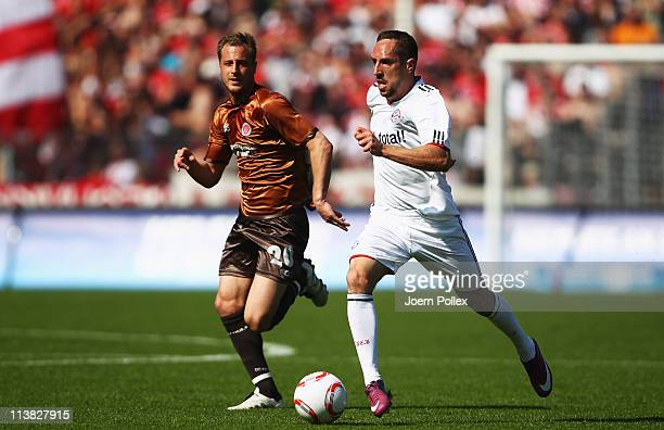Matthias Lehmann of St Pauli and Franck Ribery of Muenchen battle for the ball during the Bundesliga match between FC St Pauli and FC Bayern Muenchen...