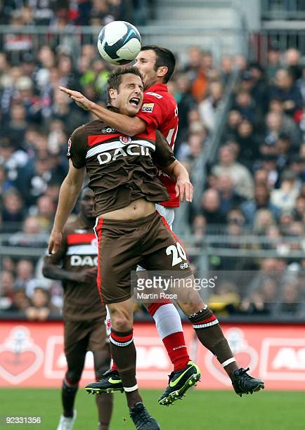 Matthias Lehmann of St Pauli and Marc Andre Kruska of Cottbus jump to head for the ball during the Second Bundesliga match between FC St Pauli and...