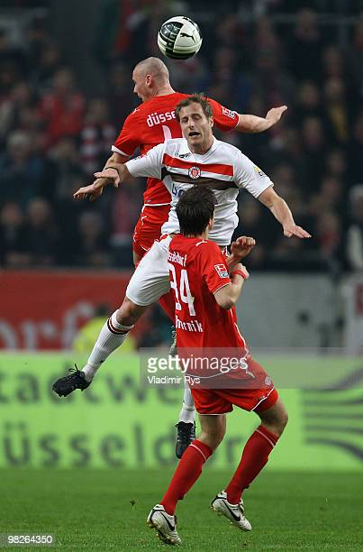 Matthias Lehmann of St Pauli and Marco Christ of Fortuna jump for a header during the Second Bundesliga match between Fortuna Duesseldorf and FC St...