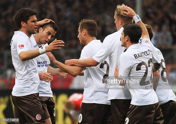 Matthias Lehmann of St Pauli celebrates with his team mates after scoring his team's first goal during the Bundesliga match between FSV Mainz 05 and...