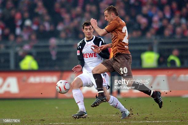 Matthias Lehmann of St Pauli challenges Mato Jajalo of Koeln during the Bundesliga match between FC St Pauli and 1 FC Koeln at Millerntor Stadium on...