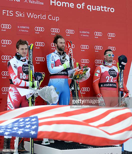 Matthias Mayer of Austria Travis Ganong of USA and Dominik Paris of Italy celebrate on the podium during the Audi FIS Alpine Ski World Cup Men's...