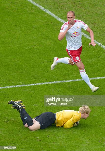Matthias Morys of Leipzig celebrates scoring his teams second goal while goalkeeper David Buchholz of Lotte looks dejected during the Regionalliga...