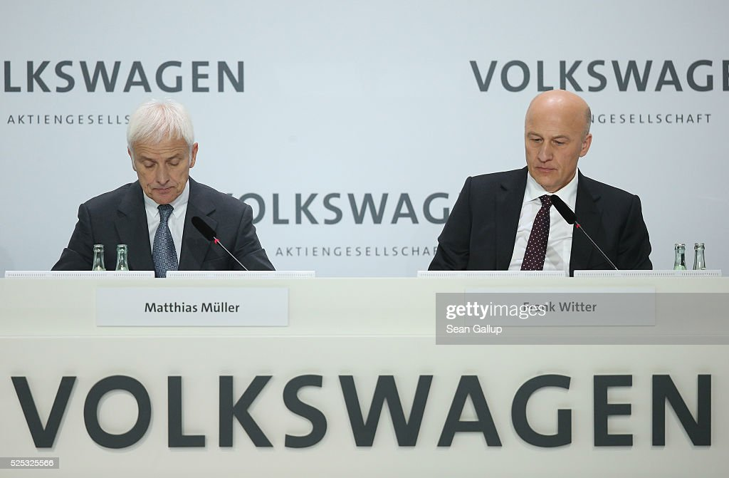 Matthias Mueller (L), CEO of German automaker Volkswagen AG, and Volkswagen CFO Frank Witter speak at the company's annual press conference on April 28, 2016 in Wolfsburg, Germany. Volkswagen is facing high costs and stiff penalties, including the possible buyback of up to 500,000 cars it sold in the USA, as a reult of VW's diesel emissions scandal.