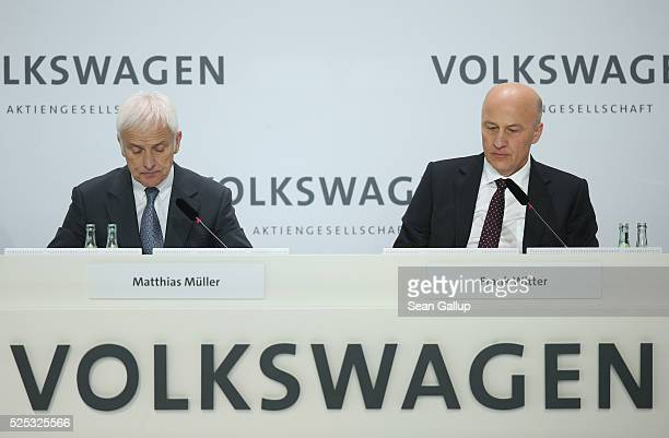 Matthias Mueller CEO of German automaker Volkswagen AG and Volkswagen CFO Frank Witter speak at the company's annual press conference on April 28...