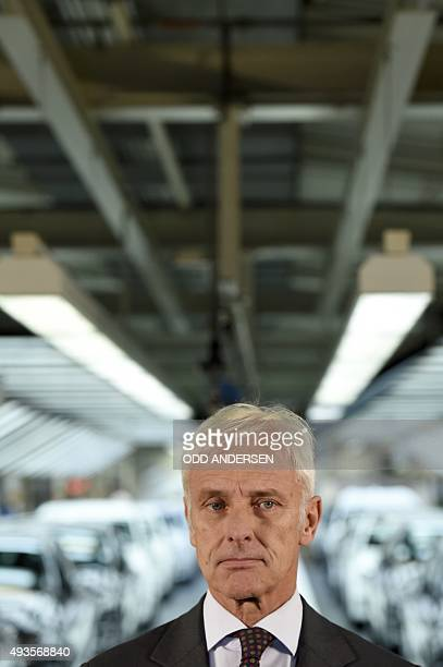 Matthias Mueller CEO of German car maker Volkswagen addresses journalists after visiting an assembly line of the VW plant in Wolfsburg central...
