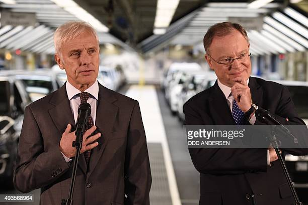 Matthias Mueller CEO of German car maker Volkswagen addresses journalists next to VW Supervisory board member and Lower Saxony State Premier Stephan...