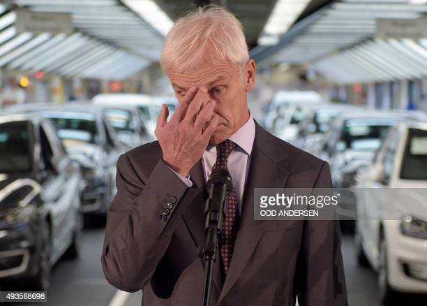Matthias Mueller CEO of German car maker Volkswagen gestures while addressing journalists after visiting an assembly line of the VW plant in...