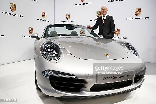 Matthias Mueller CEO of Porsche AG poses for the media prior to the annual results press conference on March 15 2013 in Stuttgart Germany 2012 was...