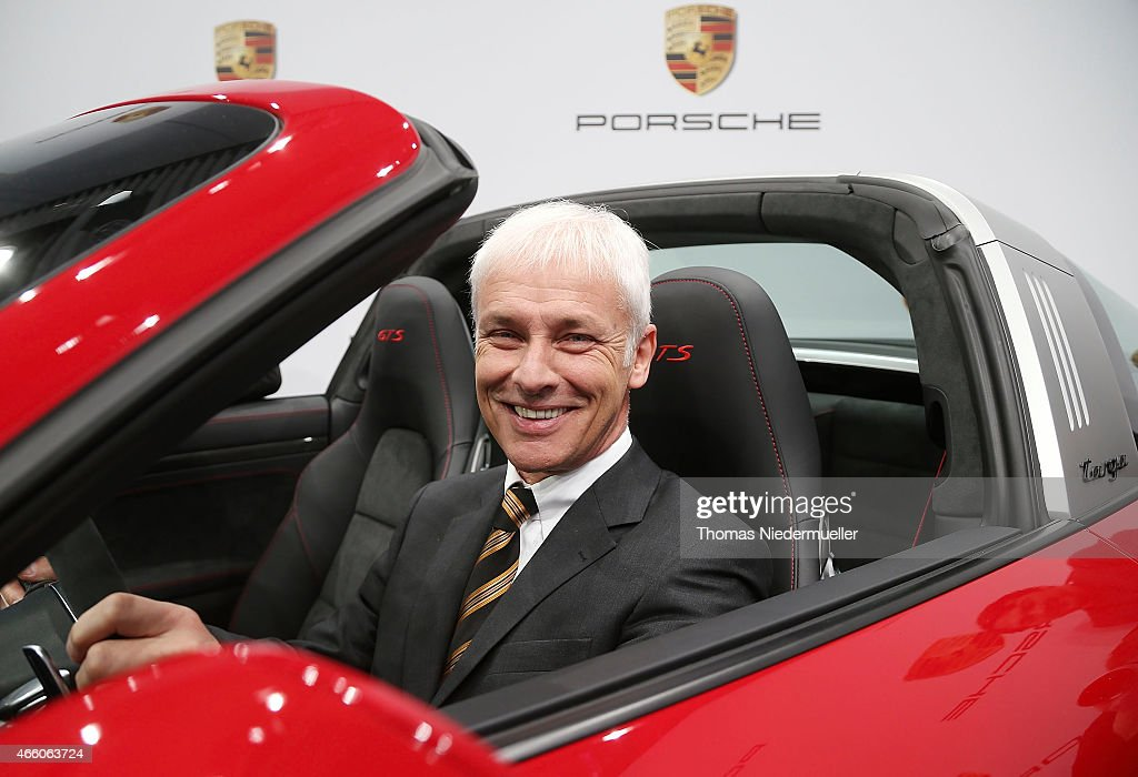 Matthias Mueller, CEO of Porsche AG poses in a Porsche Targa 4 GTS at the Porsche AG annual press conference on March 13, 2015 in Stuttgart, Germany. The conference focused on the successful return of the Porsche team to top-line endurance racing and the record revenues and earnings in 2014.