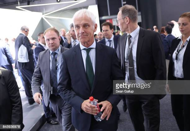 Matthias Mueller CEO of Volkswagen walks between presentaitons in the Volkswagen hall at the 2017 Frankfurt Auto Show on September 12 2017 in...