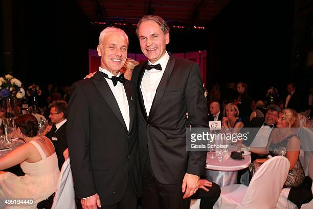 Matthias Mueller CEO Volkswagen AG formerly Porsche and Oliver Blume new CEO Porsche AG during the Leipzig Opera Ball 2015 on October 31 2015 in...