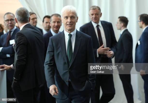 Matthias Mueller Chairman of German automaker Volkswagen AG arrives with other VW executives for the company's annual press conference to present its...