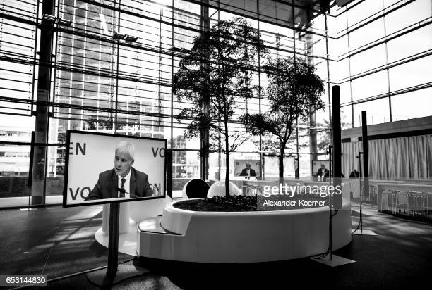 Matthias Mueller Chairman of German automaker Volkswagen AG is displayed on TV during the company's annual press conference to present its financial...