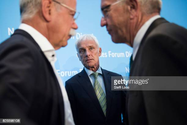 Matthias Mueller Chairman of Volkswagen AG Dieter Zetsche chairman of German car maker Daimler AG and Governor of BadenWuerttemberg Winfried...
