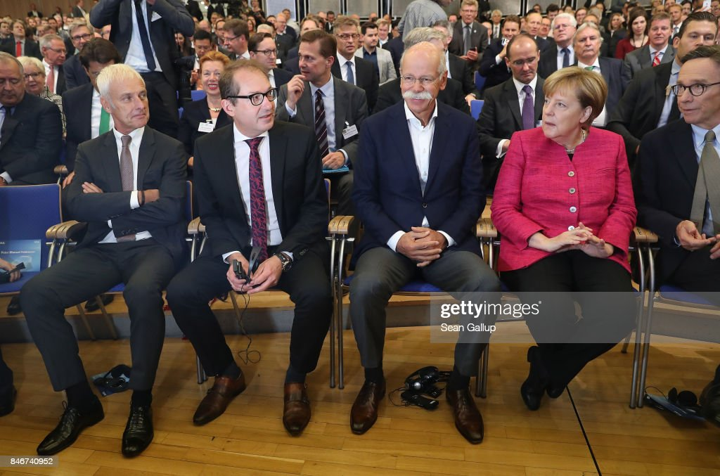Matthias Mueller, Chairman of Volkswagen AG, German Transport Minister Alexander Dobrindt, Dieter Zetsche, Chairman of Daimler AG, and German Chancellor Angela Merkel attend the opening event at the 2017 IAA Frankfurt Auto Show on September 14, 2017 in Frankfurt am Main, Germany. The Frankfurt Auto Show is taking place during a turbulent period for the auto industry. Leading companies have been rocked by the self-inflicted diesel emissions scandal. At the same time the industry is on the verge of a new era as automakers commit themselves more and more to a future that will one day be dominated by electric cars.