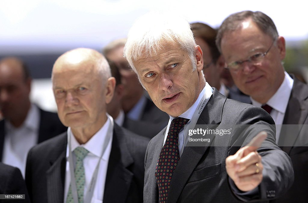 Matthias Mueller, chief executive officer of Porsche AG, stands with Ferdinand Piech, chairman of Volkswagen AG, left, as they look at a display of automobiles at the Volkswagen AG annual general meeting (AGM) in Hanover, Germany, on Thursday, April 25, 2013. Volkswagen AG, Europe's biggest automaker, aims to offset plunging European demand this year by rolling out 60 new and updated models, including luxury cruisers like the Bentley Flying Spur. Photographer: Chris Ratcliffe/Bloomberg via Getty Images