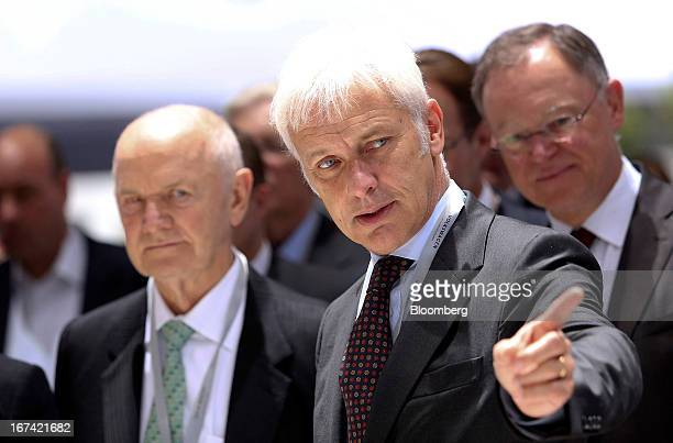 Matthias Mueller chief executive officer of Porsche AG stands with Ferdinand Piech chairman of Volkswagen AG left as they look at a display of...