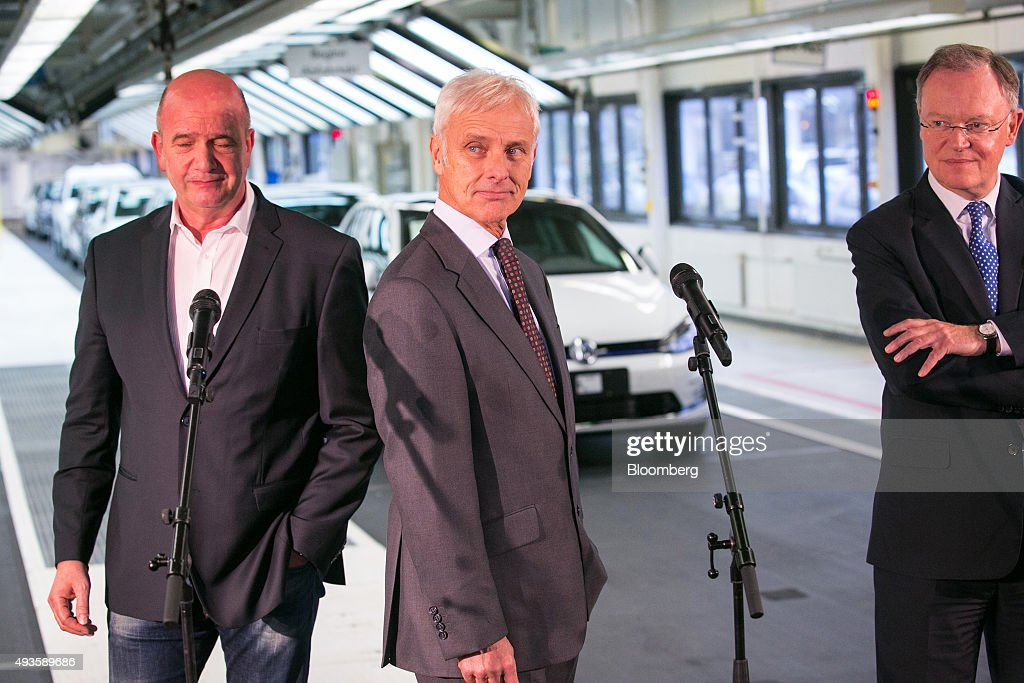 Matthias Mueller, chief executive officer of Volkswagen AG, center, Bernd Osterloh, labor leader of Volkswagen AG, left, and <a gi-track='captionPersonalityLinkClicked' href=/galleries/search?phrase=Stephan+Weil&family=editorial&specificpeople=4683319 ng-click='$event.stopPropagation()'>Stephan Weil</a>, prime minister of the German state of Lower Saxony, arrive for a news conference after meeting with employees on the VW Golf automobile assembly line, at the automaker's headquarters in Wolfsburg, Germany, on Wednesday, Oct. 21, 2015. Faced with billions of euros in costs for its emissions cheating scandal, Volkswagen may have to consider an overhaul of a 12-brand empire built in the last two decades that makes everything from cheap cars to motorbikes to heavy trucks. Photographer: Krisztian Bocsi/Bloomberg via Getty Images