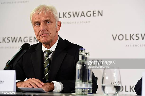 Matthias Mueller head of German automaker Porsche speaks to the media after the governing board of Volkswagen announced he will succeed former...