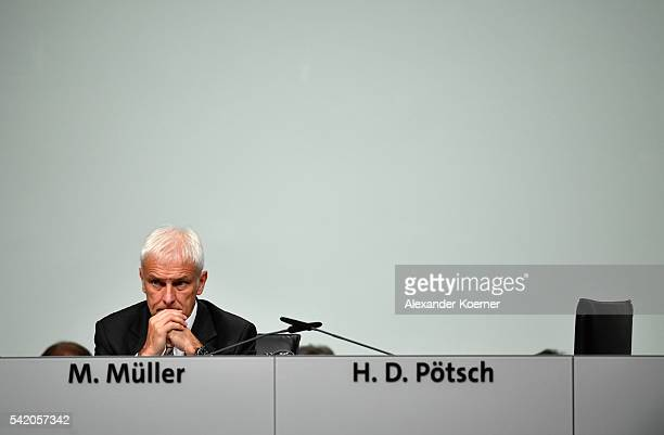 Matthias Mueller head of German automaker Volkswagen AG arrives for the annual Volkswagen general shareholders meeting on June 22 2016 in Hanover...
