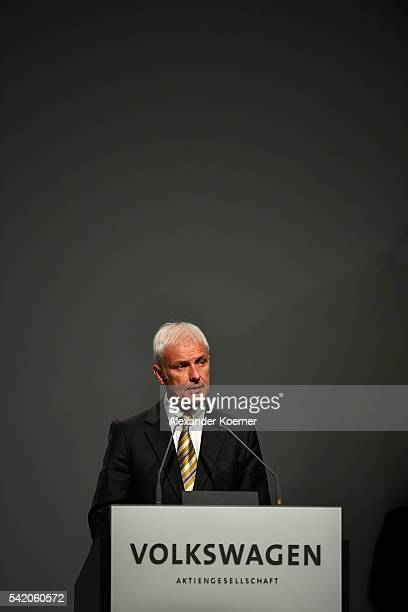 Matthias Mueller head of German automaker Volkswagen AG speaks on stage during the annual Volkswagen general shareholders meeting on June 22 2016 in...
