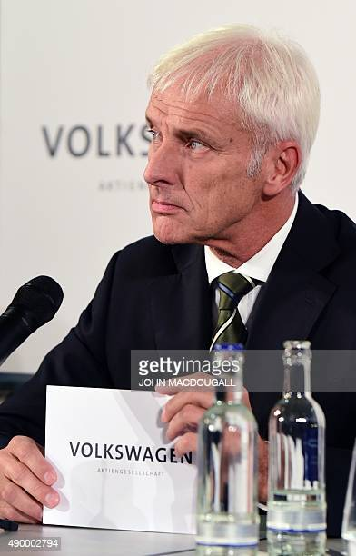 Matthias Mueller newly appointed CEO of German car maker Volkswagen addresses a press conference at the company's the headquarters in Wolfsburg...