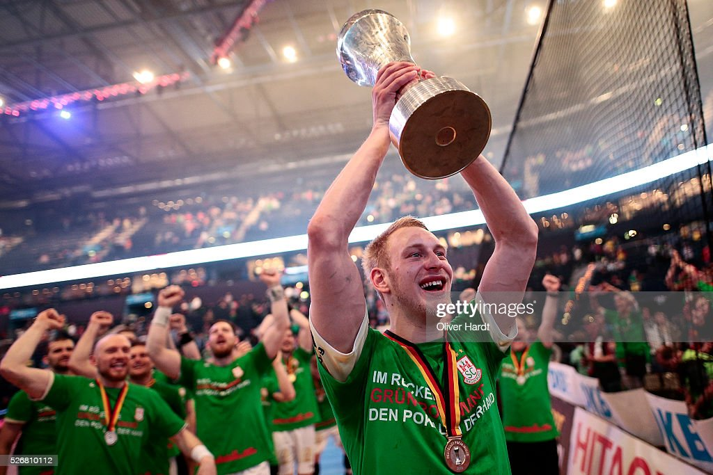 Matthias Musche of Magdeburg celebrate with the trophy after winning the DKB REWE Final Four Finale 2016 between SG Flensburg Handewitt and SC Magdeburg at Barclaycard Arena on May 1, 2016 in Hamburg, Germany.