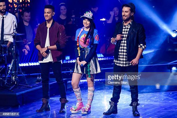 Matthias Nzola Zanquila JamieLee Kriewitz and Tobias Vorwerk are seen on stage during the The Voice Of Germany 1st Live Show on December 3 2015 in...