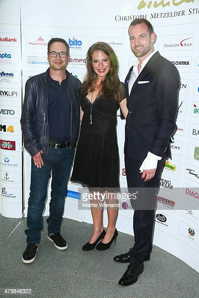 Matthias Opdenhoevel Mara Bergmann and Christoph Metzelder pose during the pre golf party of the 7th Golf Charity Cup hosted by the Christoph...