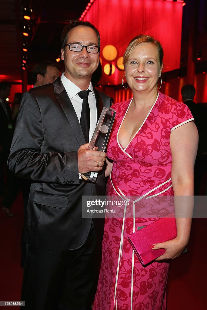Matthias Opdenhoevel with his award and partner attend the German TV Award party 2012 (Deutscher Fernsehpreis 2012) at Coloneum on October 2, 2012 in Cologne, Germany.