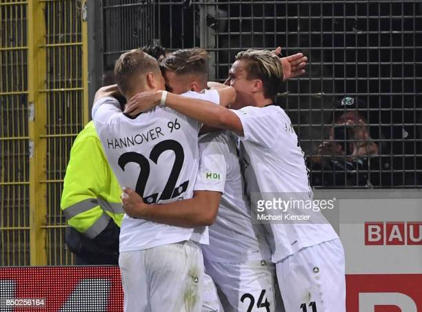 Matthias Ostrzolek Martin Harnik and Felix Klaus of Hannover 96 celebrates goal of Harnik during the Bundesliga match between Sport Club Freiburg and...