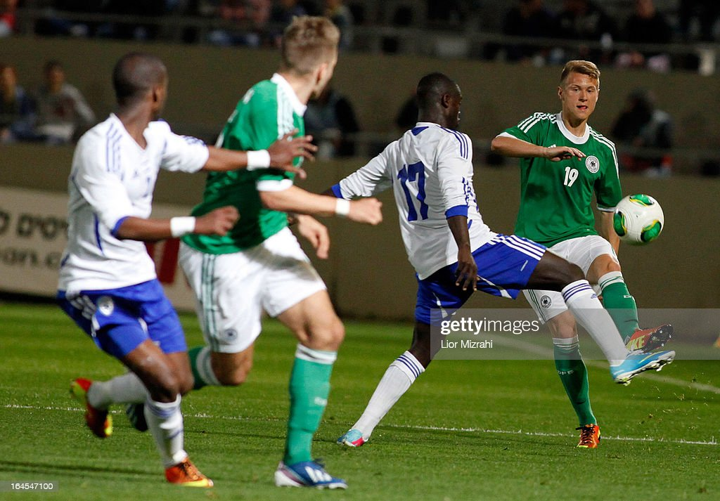 Matthias Ostrzolek of Germany challenges Sintayehu Salllalich of Israel during the Under 21 International Friendly match between Israel and Germany on March 24 2013 in Tel Aviv , Israel.