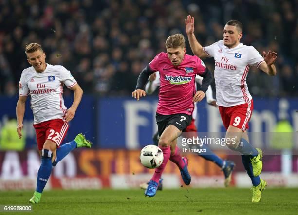 Matthias Ostrzolek of Hamburg and Alexander Esswein of Hertha BSC Berlin and Kyriakos Papadopoulos of Hamburg battle for the ball during the...