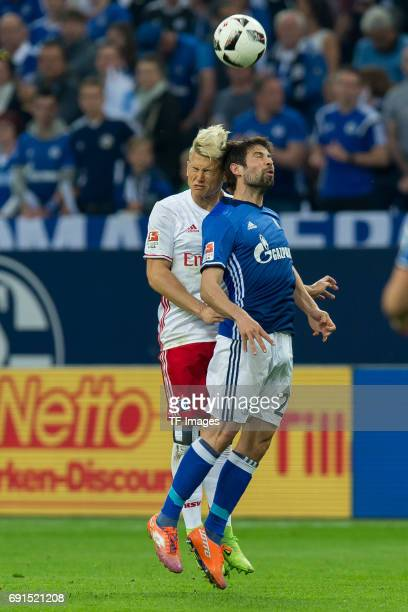 Matthias Ostrzolek of Hamburg and Coke of Schalke battle for the ball during to the Bundesliga match between FC Schalke 04 and Hamburger SV at...