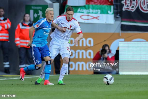 Matthias Ostrzolek of Hamburg and Dominik Kohr of Augsburg battle for the ball during the Bundesliga match between FC Augsburg and Hamburger SV at...