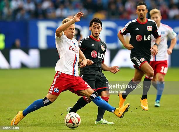 Matthias Ostrzolek of Hamburg and Hakan Calhanoglu of Leverkusen battle for the ball during the Bundesliga match between Hamburger SV and Bayer 04...