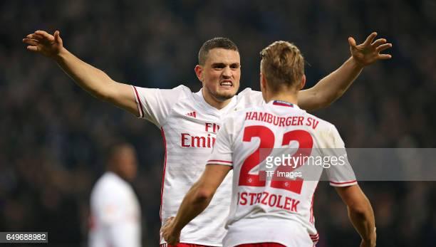 Matthias Ostrzolek of Hamburg and Kyriakos Papadopoulos of Hamburg looks on during the Bundesliga match between Hamburger SV and Hertha BSC at...
