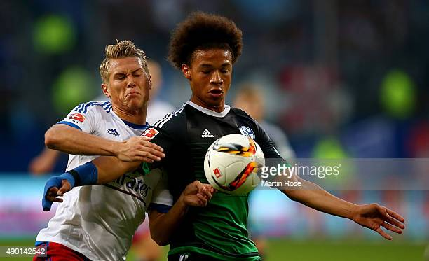 Matthias Ostrzolek of Hamburg and Leroy Sane of Schalke battle for the ball during the Bundesliga match between Hamburger SV and FC Schalke 04 at...