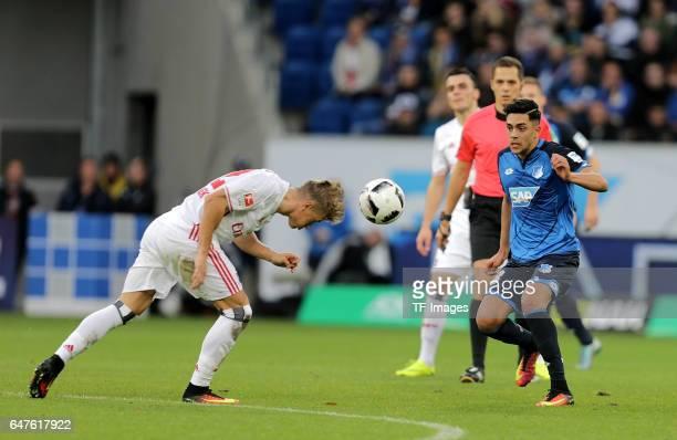 Matthias Ostrzolek of Hamburg and Nadiem Amiri of Hoffenheim battle for the ball during the Bundesliga match between TSG 1899 Hoffenheim and...