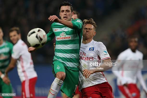 Matthias Ostrzolek of Hamburg and Zlatko Junuzovic of Bremen compete for the ball during the Bundesliga match between Hamburger SV and Werder Bremen...