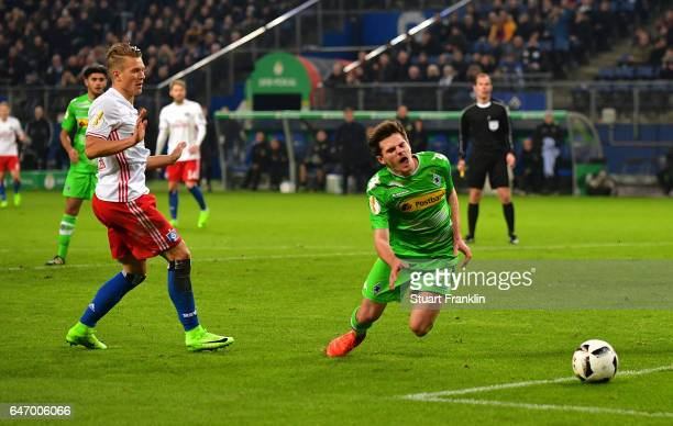 Matthias Ostrzolek of Hamburg brings down Jonas Hofmann of Gladbach leading to the second penalty during the DFB Cup quarter final between Hamburger...