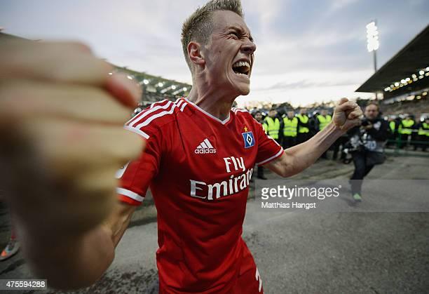 Matthias Ostrzolek of Hamburg celebrates victory after the second leg of the Bundesliga playoff match between Karlsruher SC and Hamburger SV at...