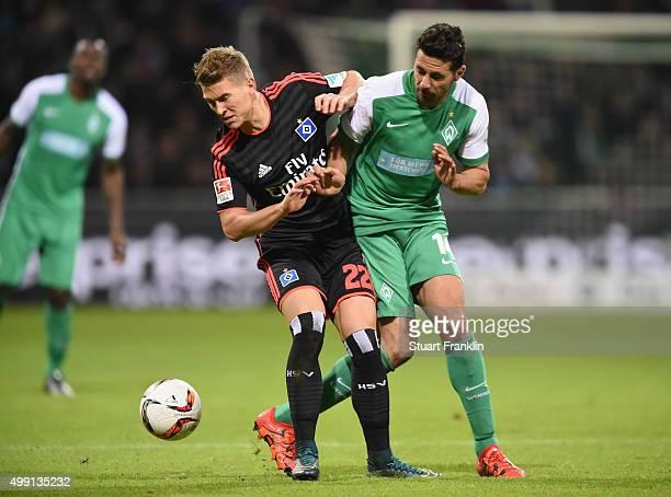 Matthias Ostrzolek of Hamburg is challenged by Claudio Pizarro of Bremen during the Bundesliga match between Werder Bremen and Hamburger SV at...