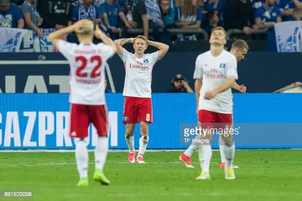 Matthias Ostrzolek of Hamburg Lewis Holtby of Hamburg gestures during to the Bundesliga match between FC Schalke 04 and Hamburger SV at VeltinsArena...
